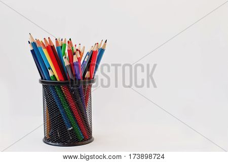 Colored Pencils In Black Pencil Case  Isolated On White Background.