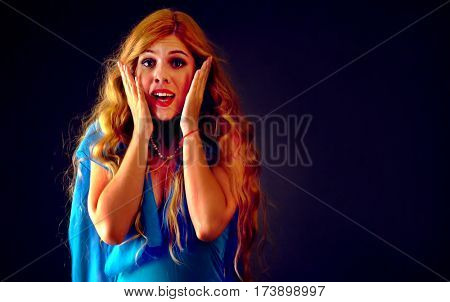 Shocked woman screaming with joyful. Surprised excited happy girl with mouth wide open shouting and presses her hands to her cheeks. Black friday holiday deals. Women's reaction to sale.