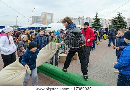 GOMEL BELARUS - MARCH 12 2016: Shrovetide entertainment. Unidentified children participate in funny fights on pillows
