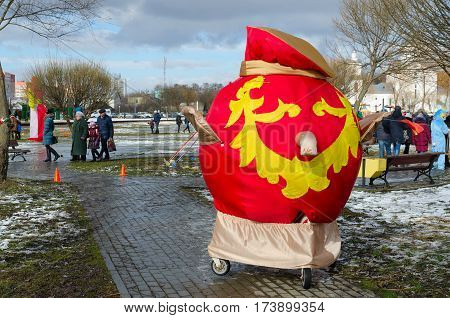 GOMEL BELARUS - FEBRUARY 25 2017: Unidentified people visit Shrovetide festivities. In foreground large samovar from bright fabric