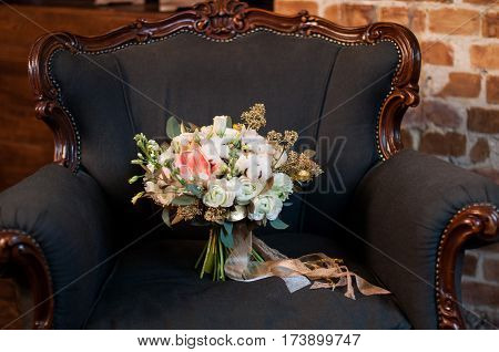 Bridal bouquet. Wedding. Wedding bouquet with cotton, white, pink, gold flowers and greenery, decorated with long silk ribbon