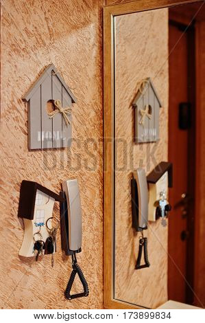 Intercom With Keys And Mirror Near Home Entrance.