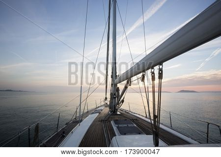 Luxury Sail Boat Sailing In Sea During Sunset