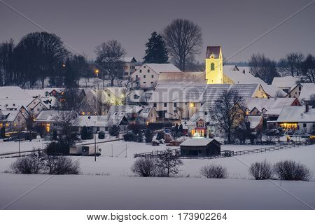 View to the village Rottbach in Bavaria Germany in winter at evening