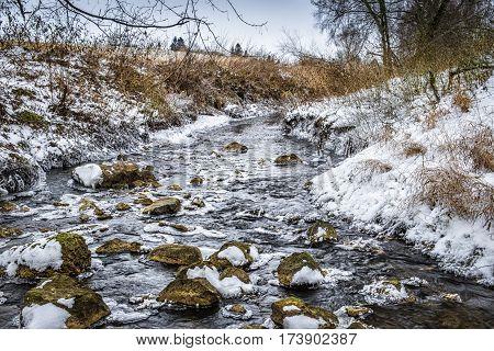 River Weiherbach near village Ueberacker in Winter