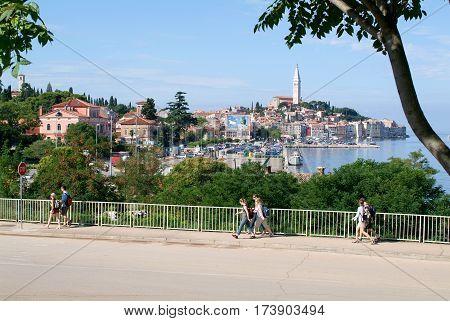 People Walking In Front Of Rovinj On Croatia