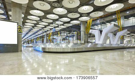 International airport baggage belt claim area. Nobody. Travel background. Horizontal