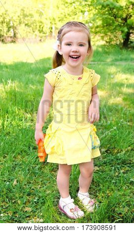 Portrait of happy cute little girl on summer day outdoor