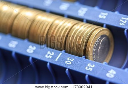 Open Cash Registrer Containing Many Coins Of Euros In Raw