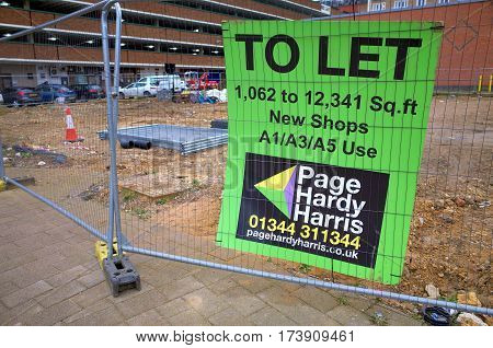 Bracknell, England - February 25, 2017: To Let sign on an area of cleared urban land available for retail construction development in Bracknell, England
