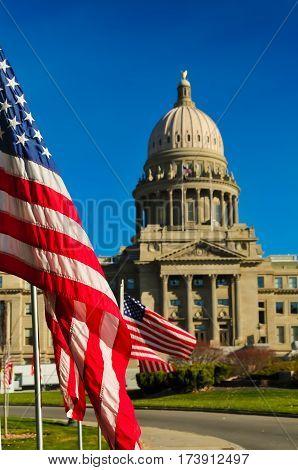 A flag waving outside of the Boise, Idaho capitol building