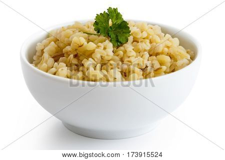 Cooked Bulgur Wheat With Green Parsley In White Ceramic Bowl Isolated On White.
