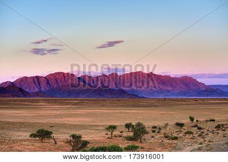 Beautiful namibian landscape at sunset Sossusvlei Namib Naukluft National Park Namibia. View from Sossusvlei lodge
