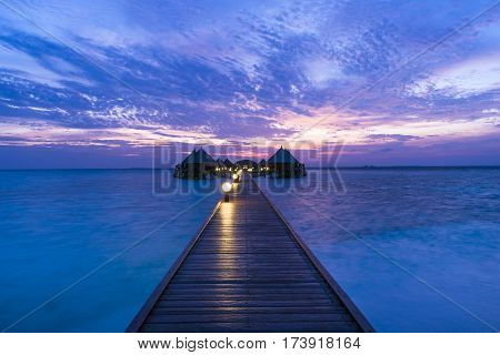 Fantastic sunset on a tropical island in the Maldives. Luxury Resort Angaga. Ari Atoll.