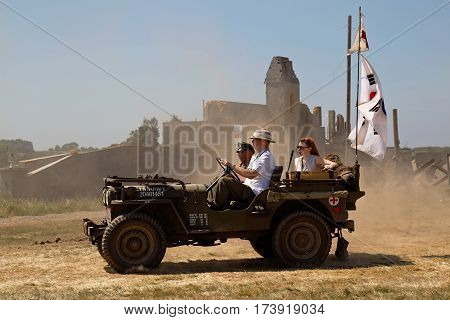 WESTERNHANGER, UK - JULY 18: A WW2 period US army jeep leaves the show arena having given a display to the public at the War & Peace show on July 18, 2013 in Westernhanger