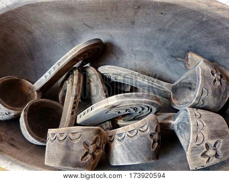 A fragment of a wooden Bratina with small buckets. Bratina - a vessel for drinking. Folk craft. Russia. Closeup.