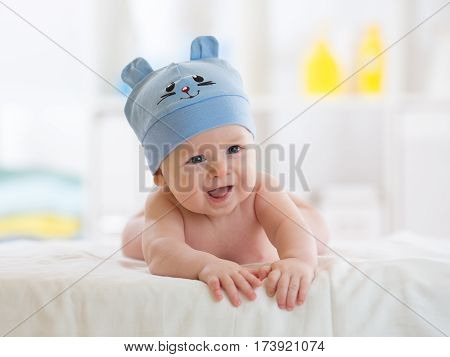 Portrait of a cute 5 months baby boy lying down on bed