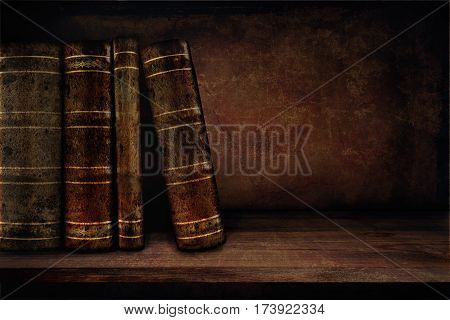 Vintage background with books on a shelf and copy space