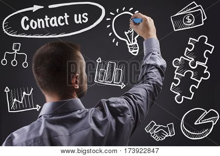 Technology, Internet, Business And Marketing. Young Business Man Writing Word: Contact Us