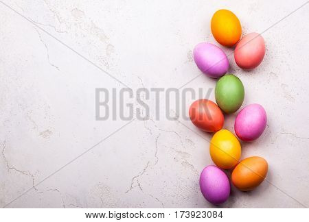 Natural dyed Easter eggs on old background. Easter concept with copy space. Flat lay