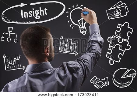 Technology, Internet, Business And Marketing. Young Business Man Writing Word: Insight