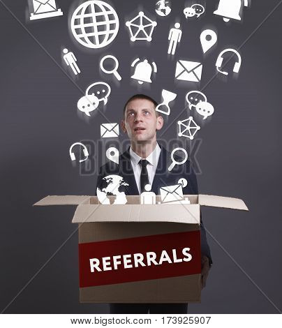 Business, Technology, Internet And Network Concept. Young Businessman Shows The Word: Referrals