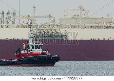 LNG TANKER AND FIREBOAT-  Gas Carrier safety secured by fireboat at the gas terminal in the port of Swinoujscie (Poland)
