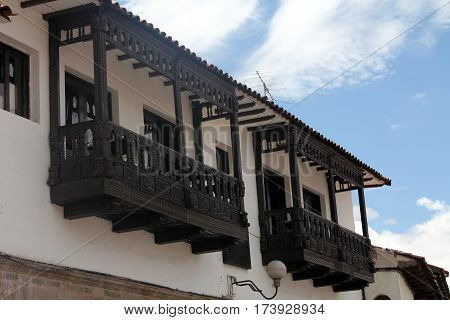 Wooden balcony of an old colonial house in Cuzco, Peru.