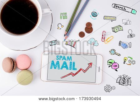 Spam Mail, Business Concept. Mobile phone and coffee cup on a white office desk.