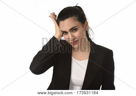young attractive business woman in office suit suffering migraine pain and strong headache with fingers on her tempo in business stress and work problem isolated on white background