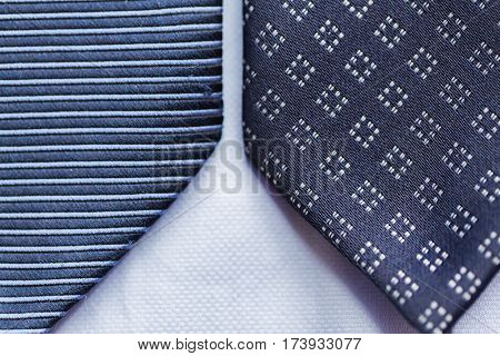 clothing, formal wear, fashion and objects concept - close up of blue patterned ties
