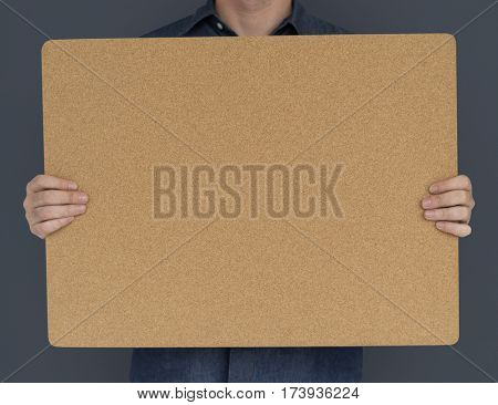 Man Holding Cork Board Copy Space Concept