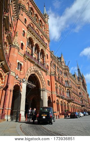 LONDON, UK - FEBRUARY 28, 2017: Exterior view of St Pancras Railway Station with a taxi in the foreground. This building  now houses the luxury St Pancras Renaissance Hotel