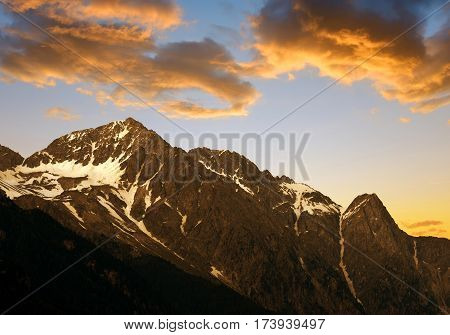 Mountain range in the valley Antholzertal at sunset, South Tyrol, Italy