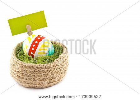 Easter Eggs In A Basket. Painted Eggs. Knitted Basket Of Jute, Sisal Green. White Background. Isolat