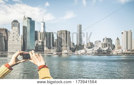 Tourist hands taking pic of New York City skyline from water taxi tour on river Hudson with digital pocket camera - Wanderlust concept and travel lifestyle around the world - Retro contrasted filter