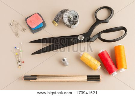 Basic Sewing Kit On An Off-white Background
