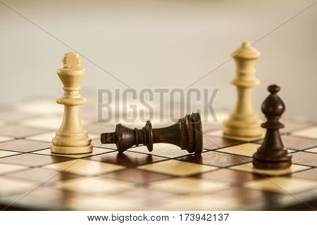 black and white chess figures on chessboard, chess game