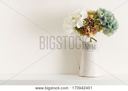 Flowers In Pitcher Vase On White Shelving