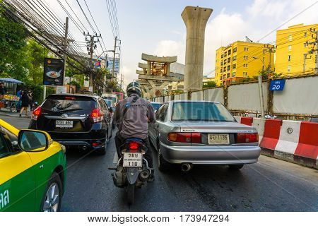 BANGKOK - FEB 22: Traffic nears Ratchayothin Overpass on a busy road in the city centre on Febuary 22 2017 in Bangkok Thailand. Effect of Bangkok Mass Transit System (BTS) Green Line