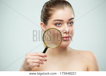 Beautiful Face of Young Woman with Clean Fresh Skin close up on gray. Beauty Portrait. Perfect Fresh Skin. Pure Beauty Model. Youth and Skin Care Concept