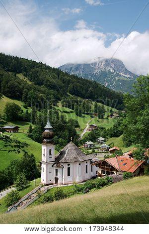 Beautiful pilgrimage church of Maria Gern with the mountain Watzmann in Bavarian Alps