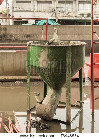 green concrete bucket at the construction site