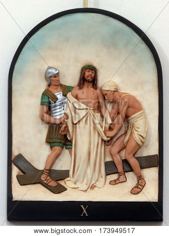 HRVATSKA DUBICA, CROATIA - NOVEMBER 18: 10th Stations of the Cross, Jesus is stripped of His garments, Parish Church of Holy Trinity in Hrvatska Dubica, Croatia on November 18, 2010.