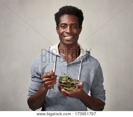Black man with salad