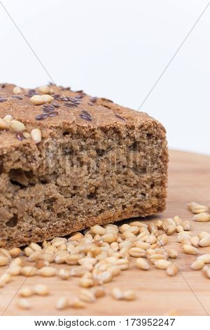 Chrono Bread On A Wooden Board With Grains Of Wheat