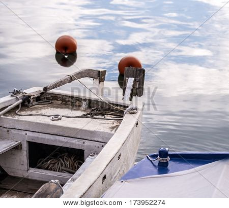 Old fishing boat without any mounted motor.