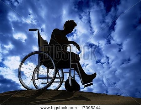Silhouette of man on a wheelchair