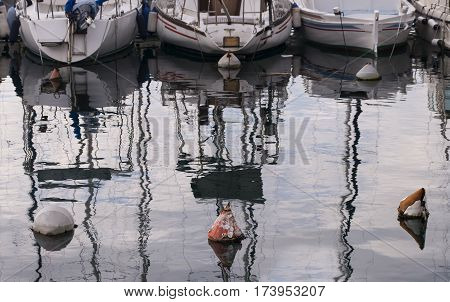 Parked boats in the marine small dock.