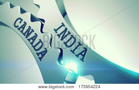 India Canada on the Mechanism of Shiny Metal Cogwheels with Glow Effect and Lens Flare - Enterprises Concept. 3D Illustration.